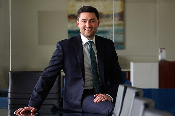 Gregory Ferra wearing suit