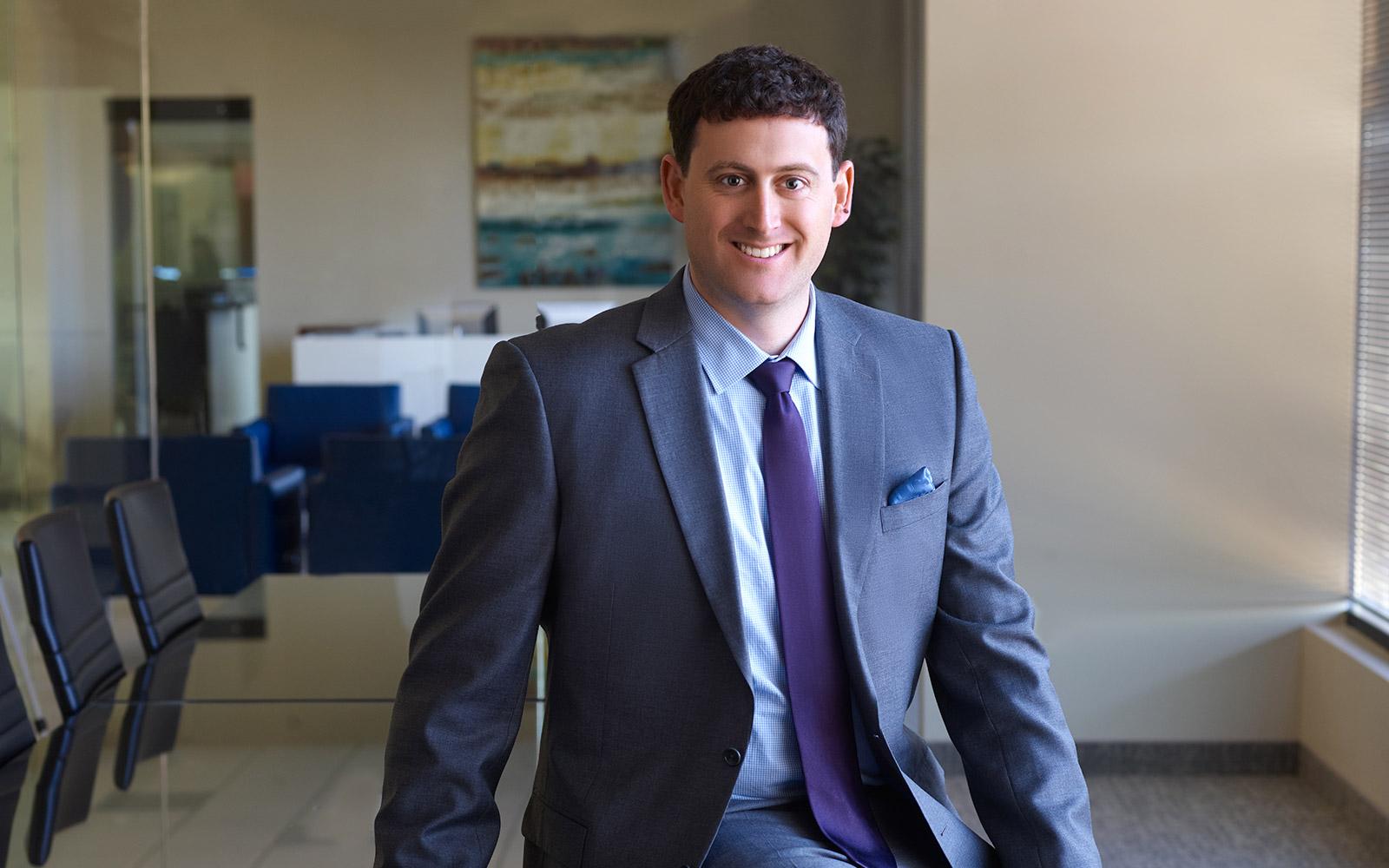 Paul Skrickus wearing suit